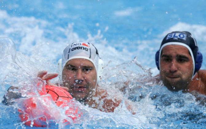 Peter Biros,left,of Hungary fights for the ball with Slovenia's Ziga Balderman, during their Group B match, at European Waterpolo championship, Friday, Sep. 1, 2006, in Belgrade, Serbia. (AP Photo/Srdjan Ilic)